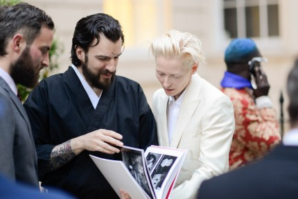 Tilda Swinton getting our Kokoro book.